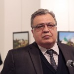 Ambassador Andrei Karlov before the shooting. With the gunman in the background moments before he shot the Russian envoy. Click to enlarge