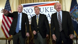 """Sen. John McCain, R-Ariz., left, Republican presidential candidate Sen. Lindsey Graham, center and former Sen. Joe Lieberman, I-Conn., right, arrive on stage at a town hall meeting at the 3 West Club to launch Graham's """"No Nukes for Iran"""" tour Monday, July 20, 2015, in New York.  (AP Photo/Kevin Hagen)"""
