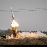 Iran wraps up military exercise, flexes muscle with firing missiles