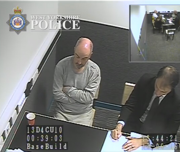 Thomas Mair in police custody the next day. Note the absence of bruising on his head. Click to enlarge