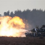 A tank fires during the US-Polish military drill in Zagan, Poland, Jan 30, 2017. Click to enlarge