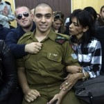 Azaria waits with his parents for the verdict inside the military court in Tel-Aviv. Click to enlarge