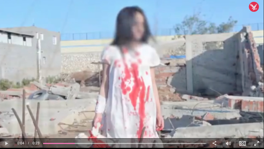If we told you this child was covered in blood would you dare to tell us we were lying? Click to enlarge