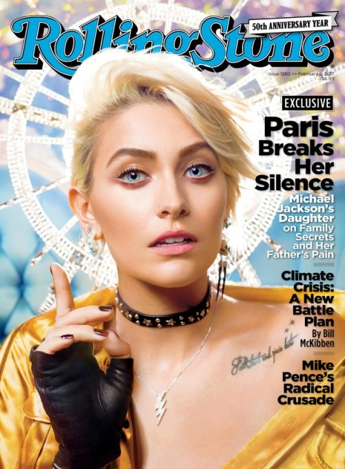 "The magazine cover features Paris with a halo behind her head, a lightning bolt pendant, a choker and the ""hand of benediction""."