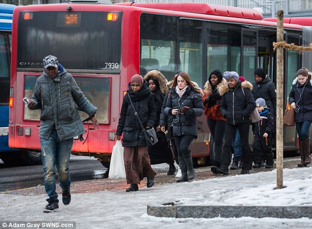Ahmed said he has been robbed twice since moving to Rinkeby, claiming the entire area is under the control of violent gangs and Monday's riots are just 'the tip of the iceberg'. Pictured: Locals alighting from a bus in Rinkeby. Click to enlarge