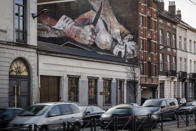 "In another example of horrific abuse being presented as ""art"", two deeply disturbing murals appeared overnight in Brussels. This one depicts a young boy held down by a man holding a knife. It is inspired by the painting ""The There is something deeply wrong with our society if this is deemed ""art"" that is OK to display in the streets. Click to enlarge"