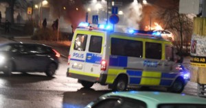 Photo of police vehicle in Stockholm during rioting, Feb. 20, 2017: AP Images