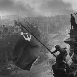Berlin. 2 May 1945. Soviet troops raise the Russian flag over the  Reichstag in Berlin. Click to enlarge