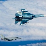 A RAF Typhoon FGR4 intercepts a Russian Su-27 Flanker over the Baltic Sea. Click to enlarge