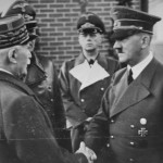 Hitler in classic Masonic handshake -thumb on knuckle- with Marshall Petain