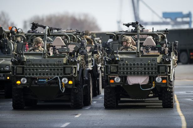 Light Dragoons Jackels prepare to embark at the port of Emden. Click to enlarge