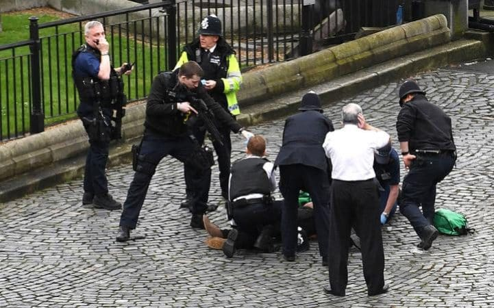 Medics treat injured attacker as armed police stand guard