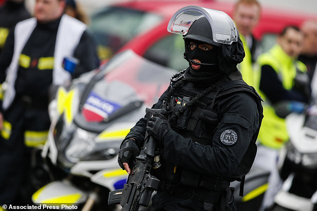 A member of the RAID, (Research, Assistance, Intervention and Deterrence), France's elite police force, patrols at Orly airport, south of Paris, Saturday, March, 18, 2017. Click to enlarge