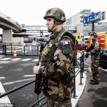 Soldiers patrol at Orly airport, south of Paris, Saturday, March, 18, 2017. Soldiers at Paris' busy Orly Aiport shot and killed a man who wrestled one of their colleagues to the ground and tried to steal her rifle Saturday, officials said. (AP Photo/Kamil Zihnioglu). Click to enlarge