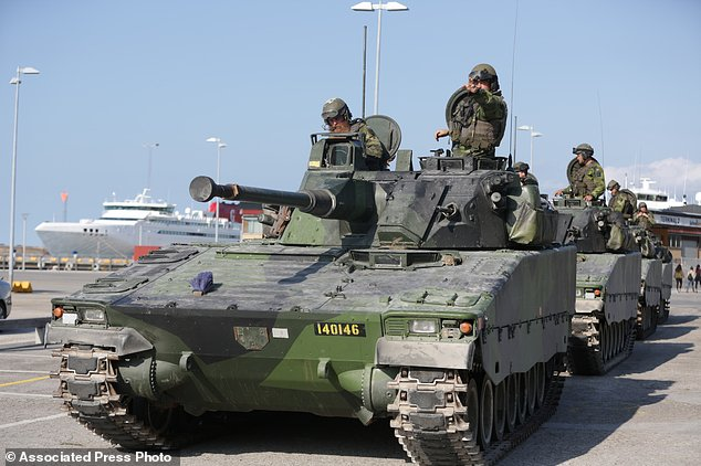 Swedish APCs in Visby harbour on the island of Gotland, Sweden. Click to enlarge