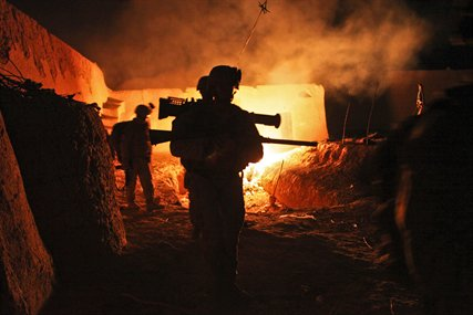 US Marines leave a compound at night in Helmand