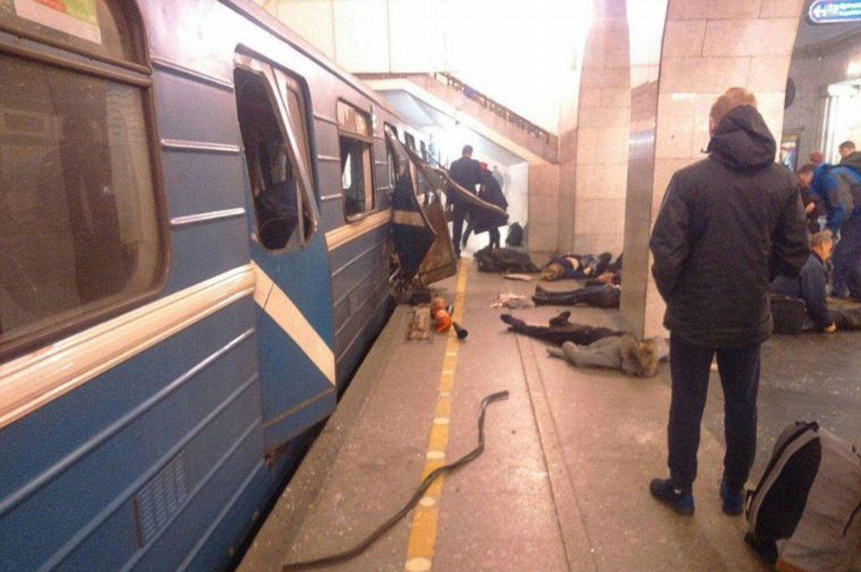 Bodies lie strewn across the platform and the doors are blown open by the blasts