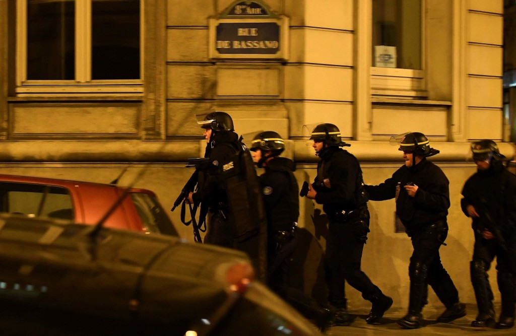 French police near the site of the shooting. Click to enlarge