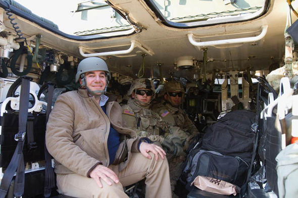 Journalist Marco-Giannangeli in a Stryker armoured vehicle.