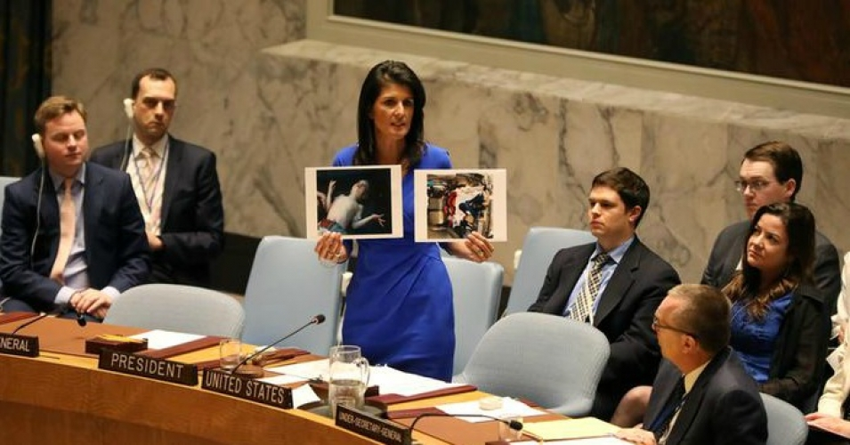 Nikki Haley shows photos of Assad's alleged victims at the Security ...