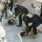 At least 58 people were killed in a toxic gas on the town of Khan Sheikhoun in central Syria in April. Here Syrian White Helmets can be seen supposedly aiding those injured. Note that the White Helmets hands are not covered and if Sarin had been used they would also have been affected without being entirely protected from chemical or biological agents. Click to enlarge
