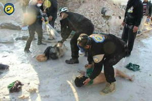 At least 58 people were killed in a toxic gas on the town of Khan Sheikhoun in central Syria on Tuesday morning. Here Syrian White Helmets can be seen supposedly aiding those injured. Note that the White Helmets hands are not covered and if Sarin had been used they would also have been affected without being entirely protected from chemical or biological agents. Click to enlarge