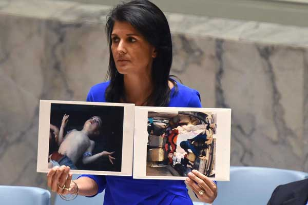 U.S. Ambassador to the UN, Nikki Halley with previous 'evidence' that Assad gassed his own people. Click to enlarge