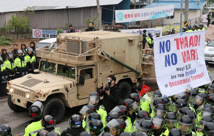 Protest meet a U.S. military vehicle which is a part of Terminal High Altitude Area Defense (THAAD) system as it arrives in Seongju, South Korea, April 26, 2017. Click to enlarge