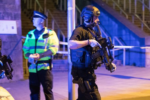 Police and armed officers at the Manchester Arena after the blast