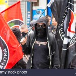 "With masks and regalia reminiscent of far-right extremists, Hope Not Hate exemplify the old warning about fascism returning in the guise of ""anti-fascism"". Click to enlarge"