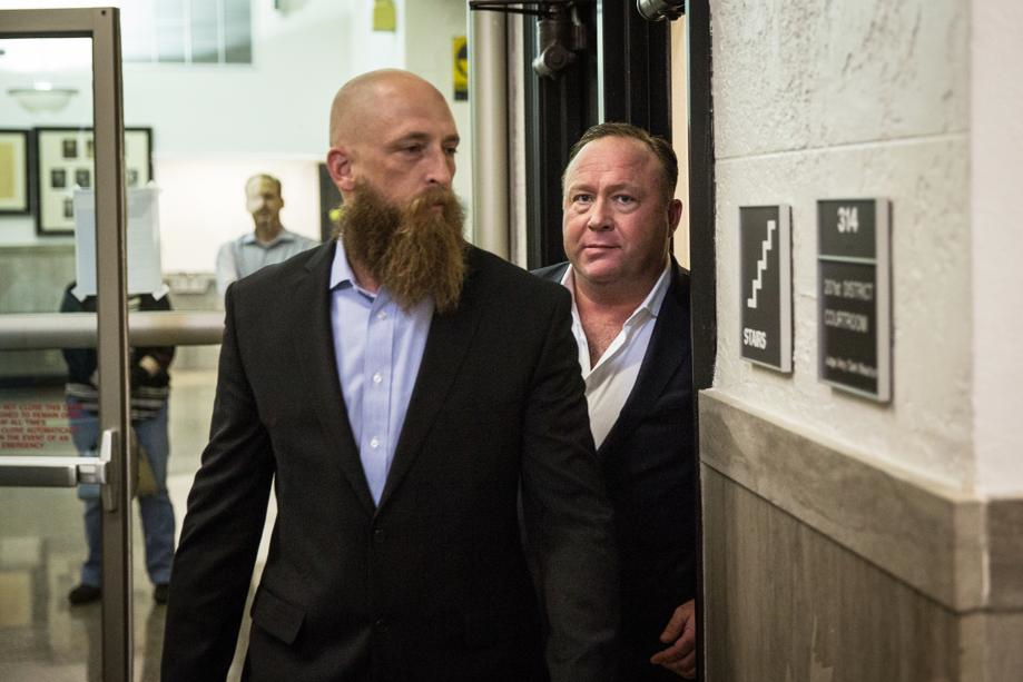 Alex Jones arrives at Travis County Family Court with his ex-Blackwater mercenary bodyguard Quentin Carter. Jones rarely ventures into public without Carter at his side. As part of his job duties with Blackwater, Carter provided physical protection to high level U.S. Govt. officials in the Middle East during the Iraq War, and now performs a similar function for Jones. Alex Jones employs several such private military contractors and U.S. Army Special-Ops agents, a fact which suggests once again that Infowars is a covert U.S. Govt. intelligence operation. Click to enlarge