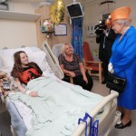 Queen Elizabeth II speaks to Millie Robson, 15, from Co Durham, and her mother, Marie, during a visit to the Royal Manchester Children's Hospital to meet victims of the terror attack in the city earlier this week and to thank members of staff who treated them.