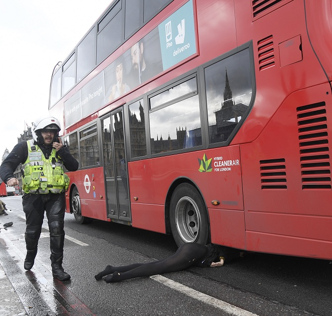 A dummy lies injured underneath a bus on Westminster Bridge in London. Click to enlarge