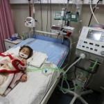 A Palestinian child with cancer recieves treatment in Gaza city hospital. Click to enlarge