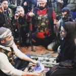 Clarissa Ward (kneeling, front right) meets with militants