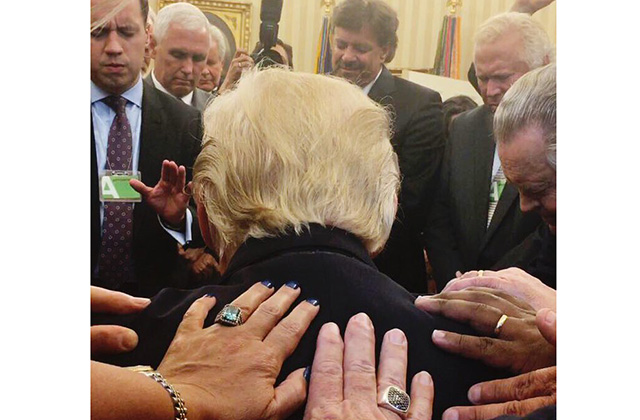 laying hands on trump
