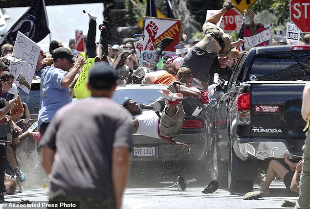 People fly into the air as a vehicle drives into a group of protesters demonstrating against a white nationalist rally in Charlottesville, Va., Saturday, Aug. 12, 2017. The nationalists were holding the rally to protest plans by the city of Charlottesville to remove a statue of Confederate Gen. Robert E. Lee. There were several hundred protesters marching in a long line when the car drove into a group of them. Click to enlarge