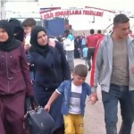 Syrian refugees return home from Turkey for Eid. Click to enlarge