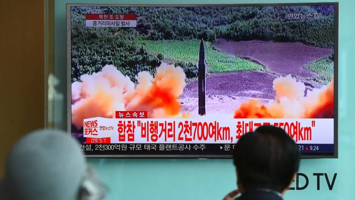 TV screen at a Seoul railway station shows footage of North Korea's latest launch. Click to enlarge