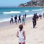 Video: Stunned Tourists Watch Migrants Invade Beach in Spain