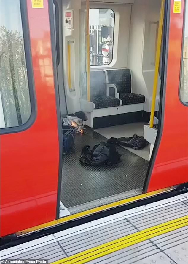 This is an image made from video showing burning items in underground train at the scene of an explosion in London Friday, Sept. 15, 2017. A reported explosion at a train station sent commuters stampeding in panic, injuring several people at the height of London's morning rush hour, and police said they were investigating it as a terrorist attack. (Sylvain Pennec via AP) Click to enlarge