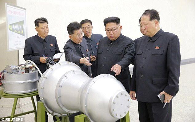 Kim Jong-Un inspects what appears to be a nuclear warhead. Click to enlarge