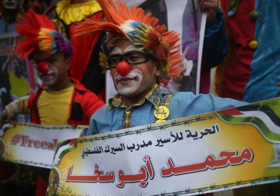 Mohammad Abu Sakhais fellow clowns demonstrate in solidarity with their detained colleague. Click to enlarge