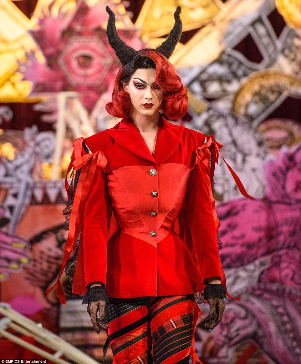 Satanic fashion show inside a church at london fashion week drag artist violet chachki wore a very red outfit and some devil horns thats biocorpaavc