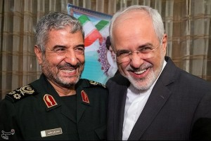 Islamic Revolutionary Guard Corps (IRGC) commander Mohammad Ali Jafari (L) and Iran's Foreign Minister Mohammad Javad Zarif smile during a coordination meeting for the 40th anniversary of the Islamic Revolution, in Tehran, Iran October 9, 2017. Tasnim News Agency/Handout via REUTERS. Click to enlarge