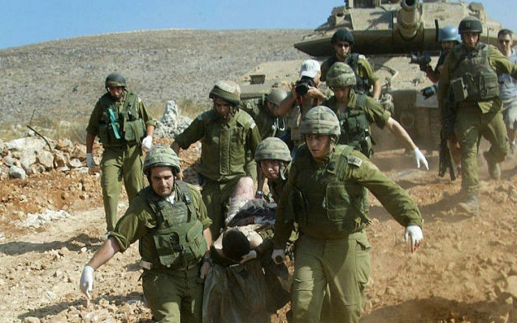 Israeli soldiers evacuate a wounded comrade during the second-lebanon-war in July 2006. Click to enlarge