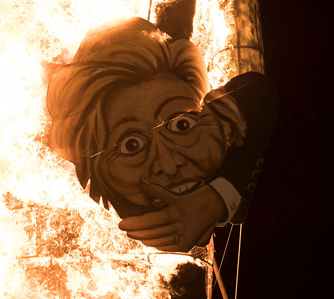 A startled looking severed head of Hillary Clinton burns in the 2016 display / Getty Images. Click to enlarge