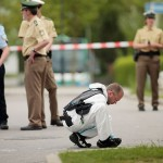 "German police secure the crime scene after a knife attack on May 10, 2016 at the train station in Grafing. A man stabbed four people while reportedly shouting ""Allahu Akbar"" (""Allah is greater""), killing one. Click to enlarge"