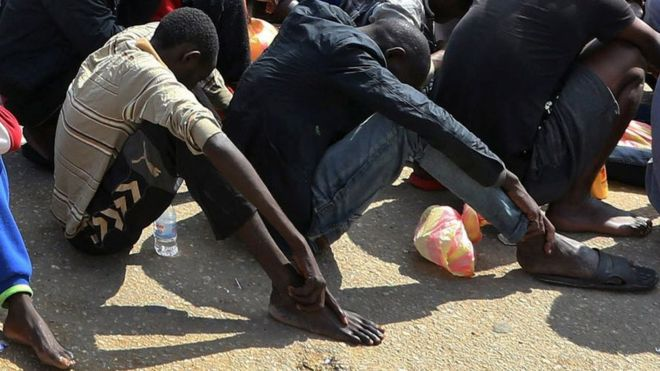 Young men being sold at Libyan slave market. Click to enlarge