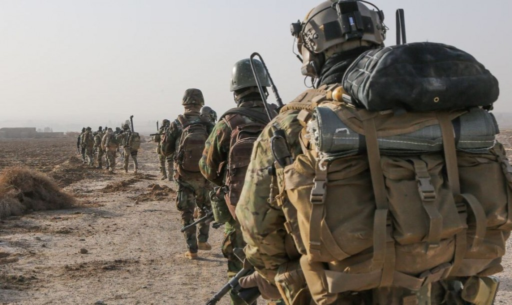 A U.S. Special Forces Soldier with Combined Joint Special Operations Task Force-Afghanistan and Afghan National Army Commandos with the 3rd Company, 3rd Special Operations Kandak move toward a compound during a clearance operation in Bahlozi, Maiwand district, Kandahar province, Afghanistan, Jan. 1, 2014. (DoD photo by Staff Sgt. Bertha A. Flores, U.S. Army/Released)